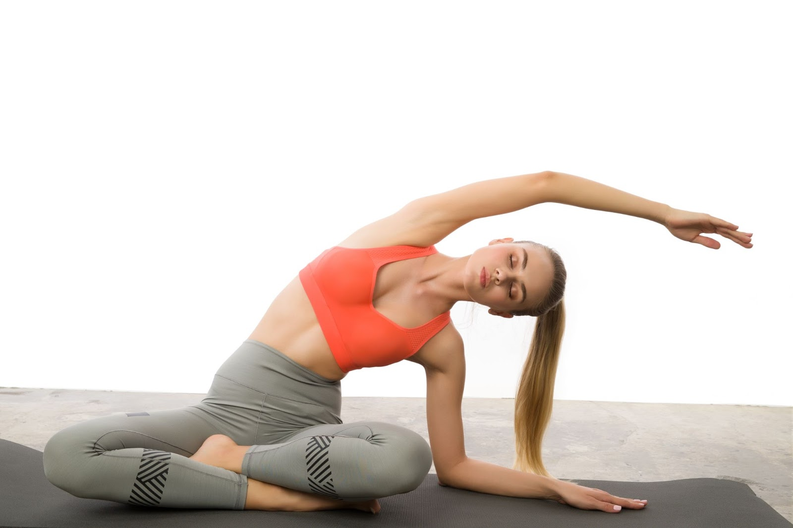 Get calm: enjoy the graphic set for the Yoga And Meditation day. Sporty young woman doing yoga